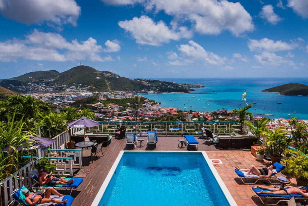 Sunbathers around the pool at Mafolie Hotel in St. Thomas US Virgin Islands.
