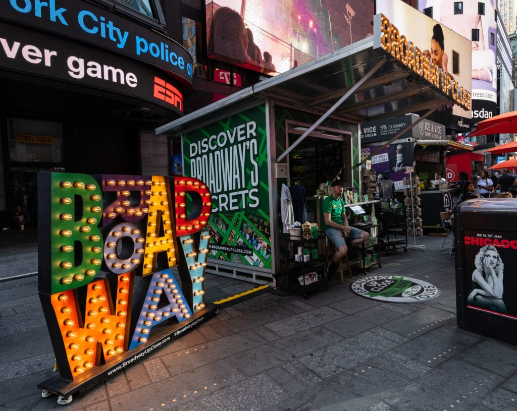 Broadway Up Close Walking Tours booth at Times Square