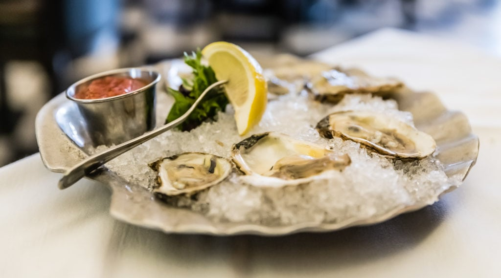 Jacks Famous Oysters served on a silver platter.