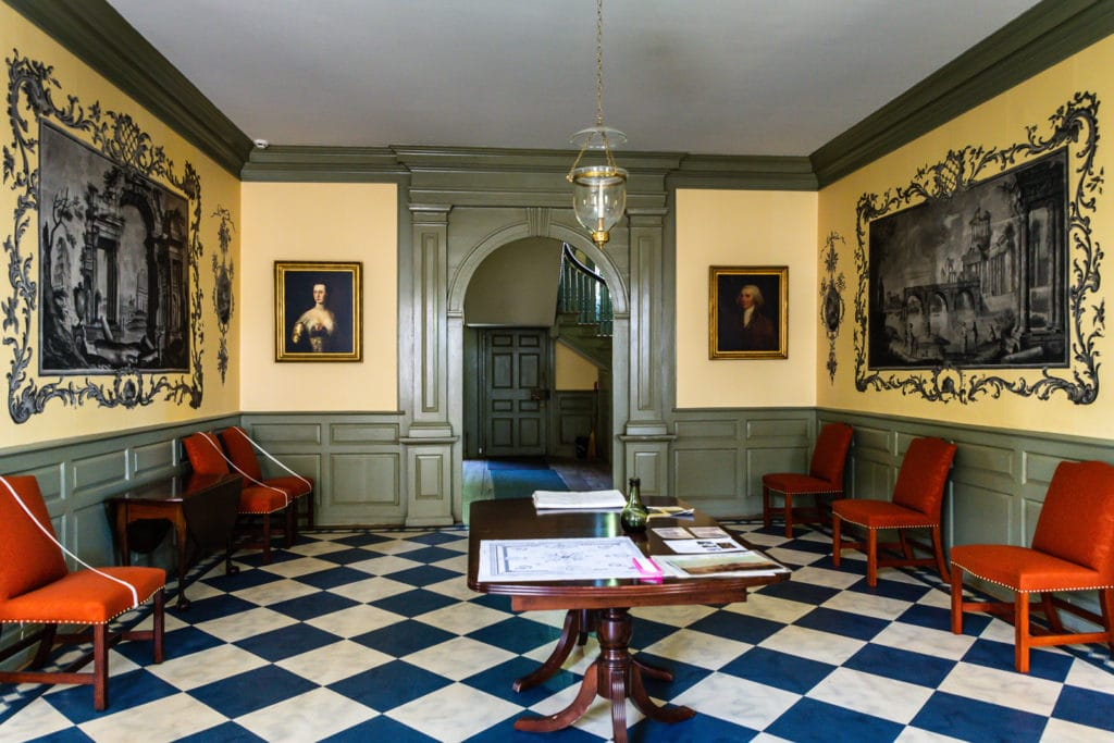 Schuyler Mansion interior with Ruins of Rome wallpaper in entry foyer.