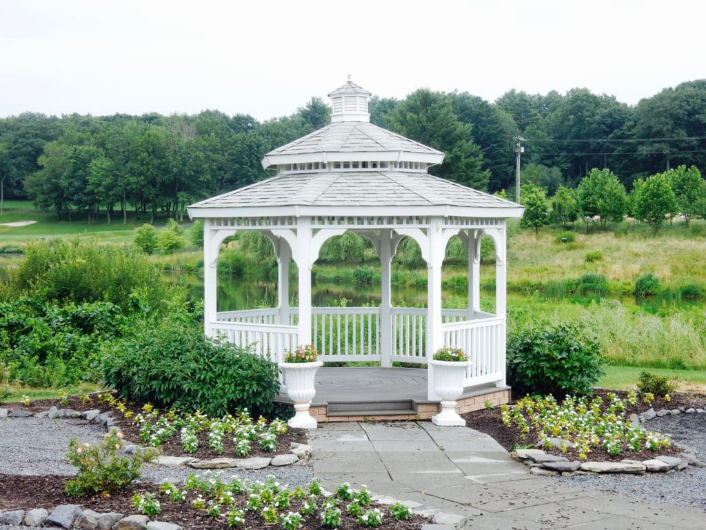 White gazebo with planted flowers around it at Mount Airy Casino
