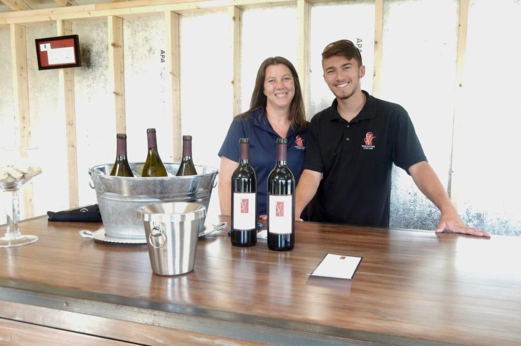 Mother-son owners of vineyard in tasting room
