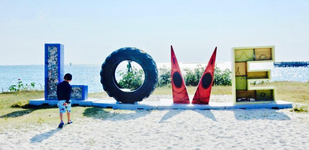 LOVE sign in sand Cape Charles VA