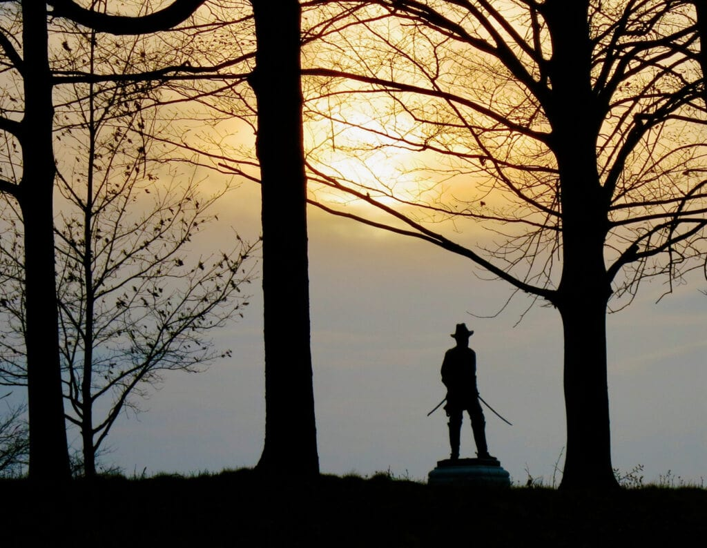 Statue of soldier in sunset Gettysburg National Battlefield