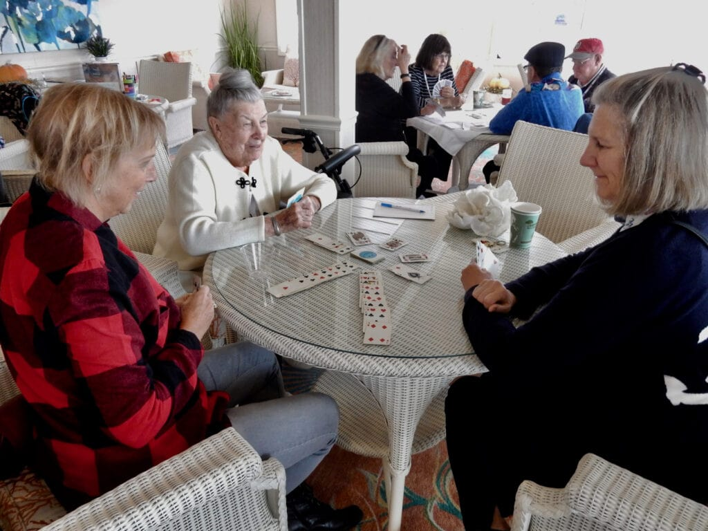 Guests playing cards on American Constitution Cruise Ship