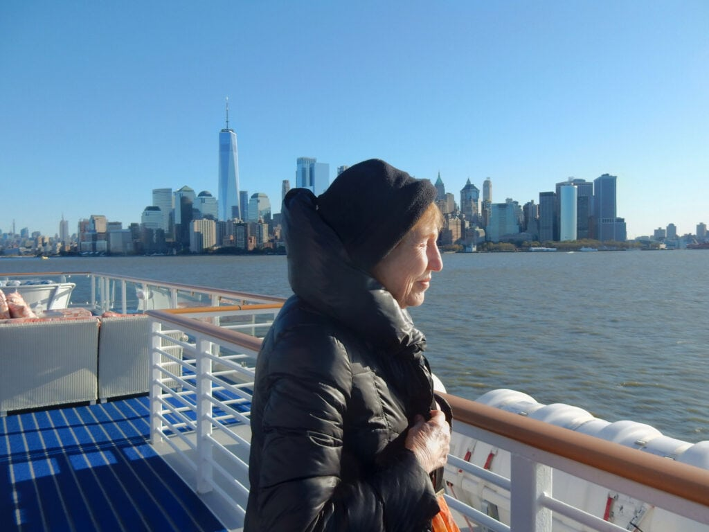 Helene enjoying sun on a cold NYC day American Cruise Lines Constitution