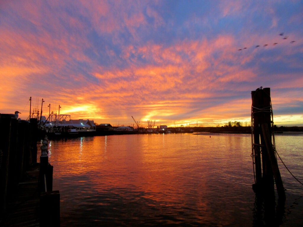Romantic New Jersey Sunset over fishing boats in Point Pleasant
