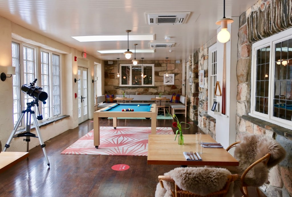 Troutbeck Sunroom doubles as billiards and dining room.