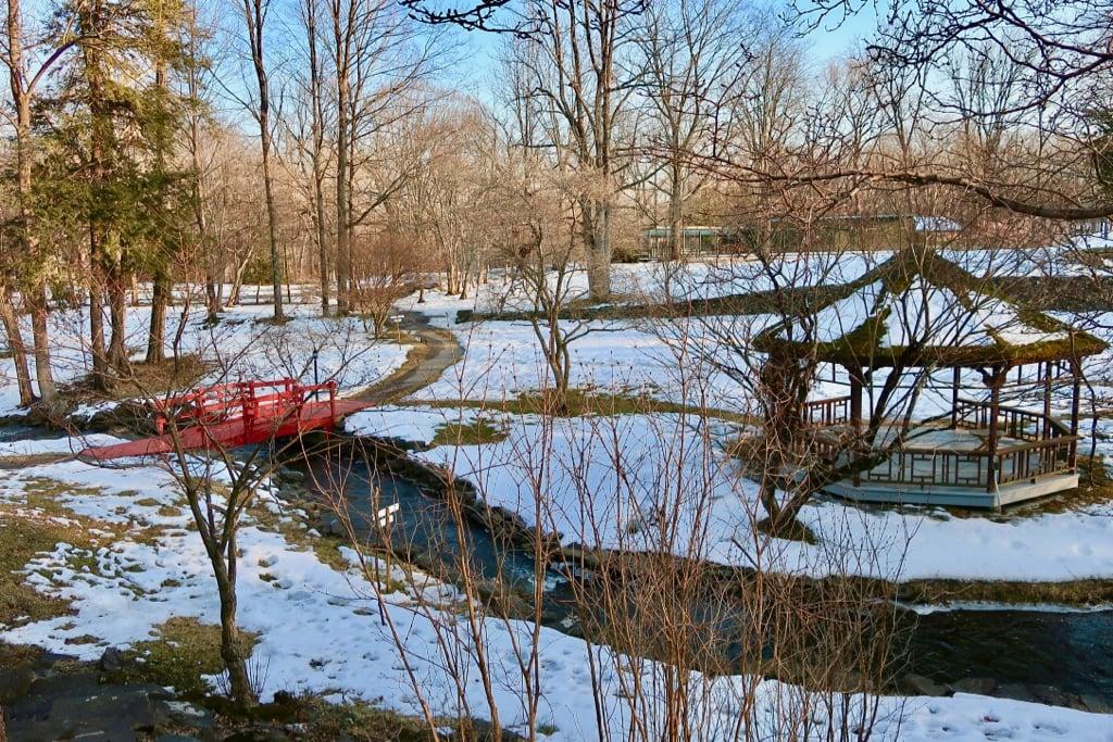 Red footbridge over Troutbeck's stream in winter