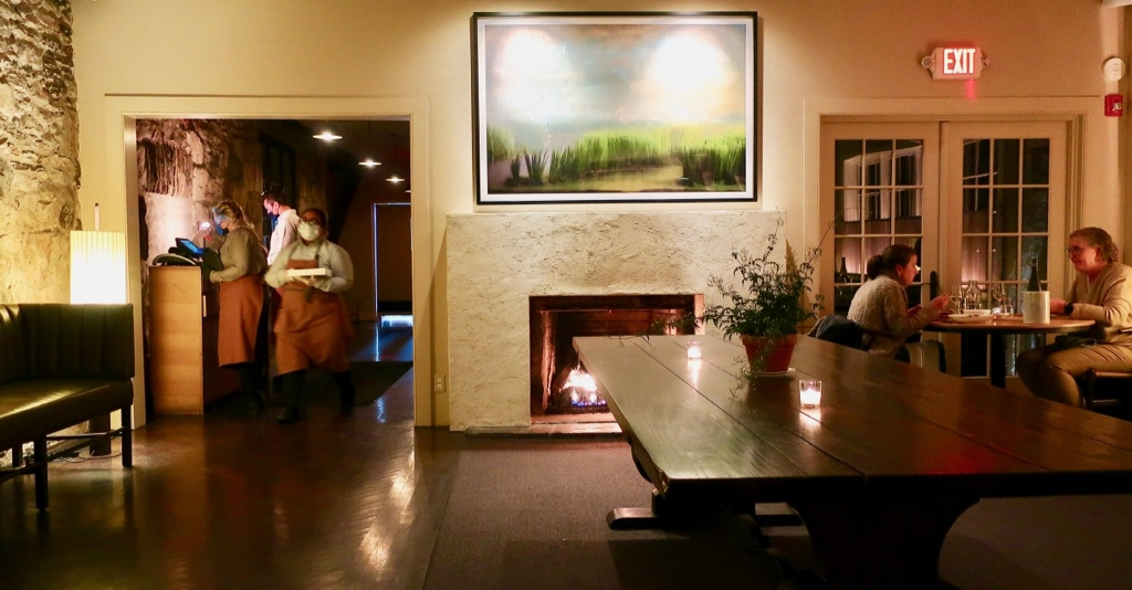 Troutbeck restaurant with evening wait staff and fireplace