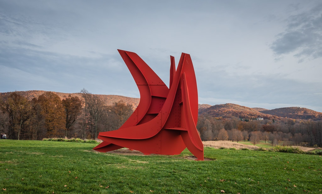 Five Swords, one of the monumental works by Alexander Calder at Storm King Outdoor Sculpture Center, seen against fall foliage backdrop.
