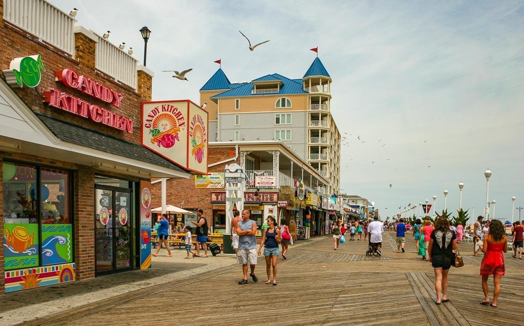 Couples strolling on the boardwalk in Ocean City MD.
