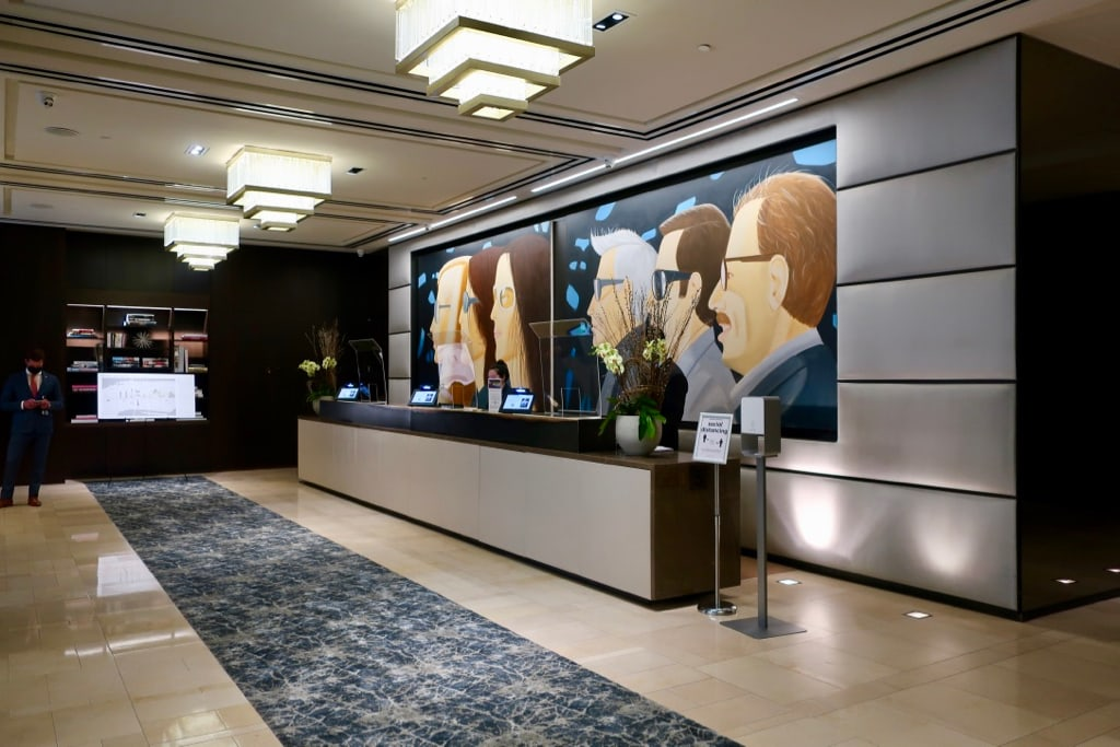 Lobby at The Langham with Alex Katz mural behind reception