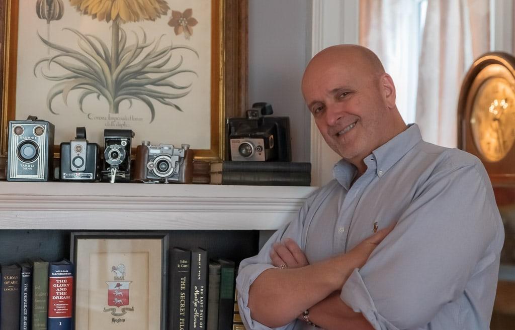 John Hughes, owner, with antique cameras, Gardner Farm Inn
