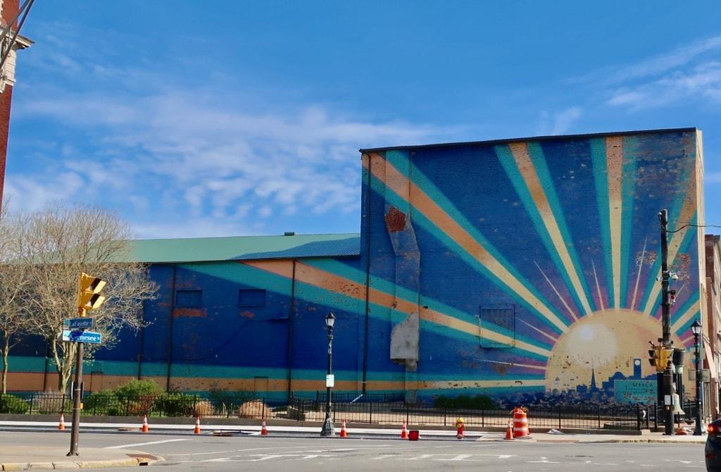 Utica rising - sun mural at entrance to I-90
