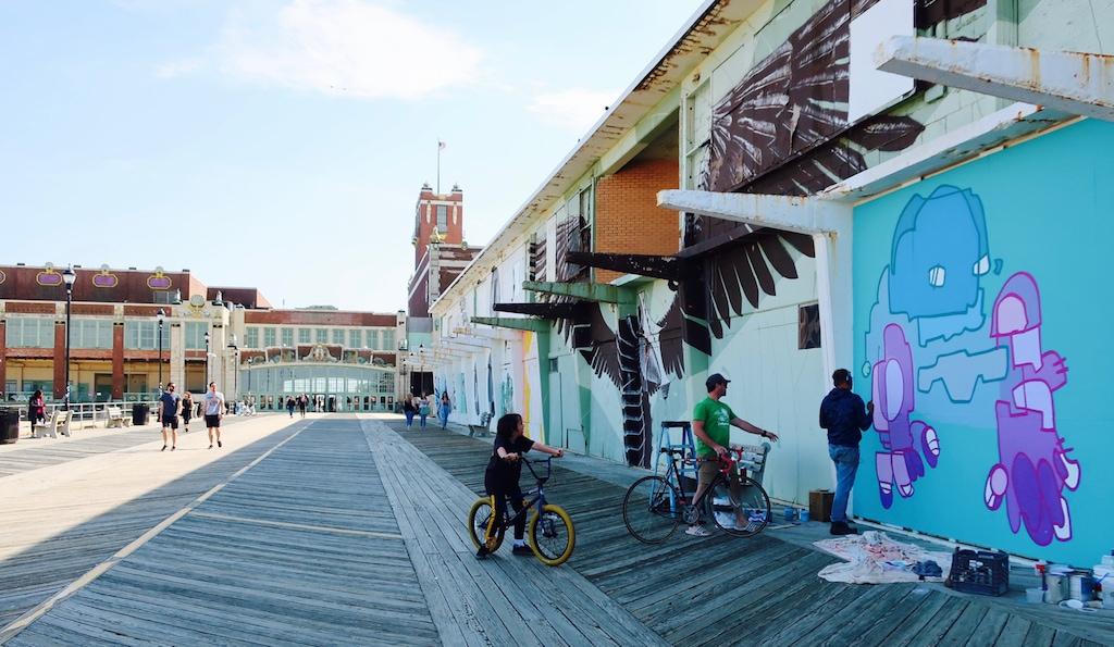 Muralist at work on the Asbury Park Boardwalk NJ