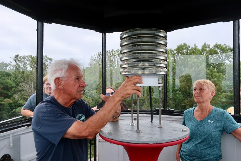 Lighting the Presque Isle Lighthouse lamp on a tour to the tower