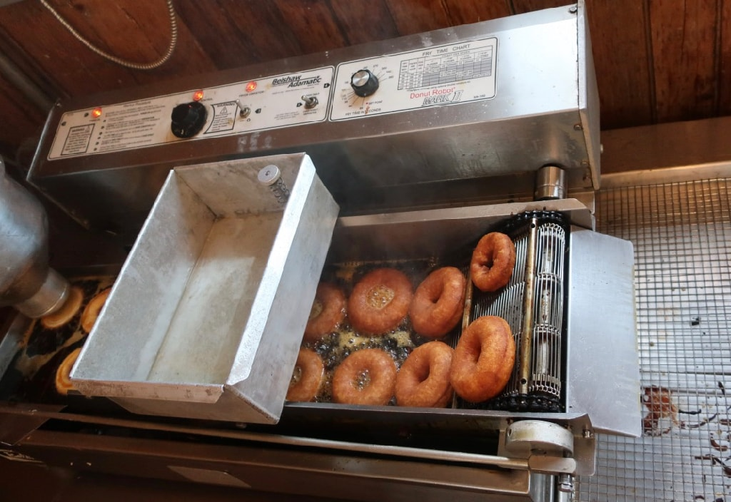 Old fashioned donut machine at Breeze Hill Farm Peconic NY