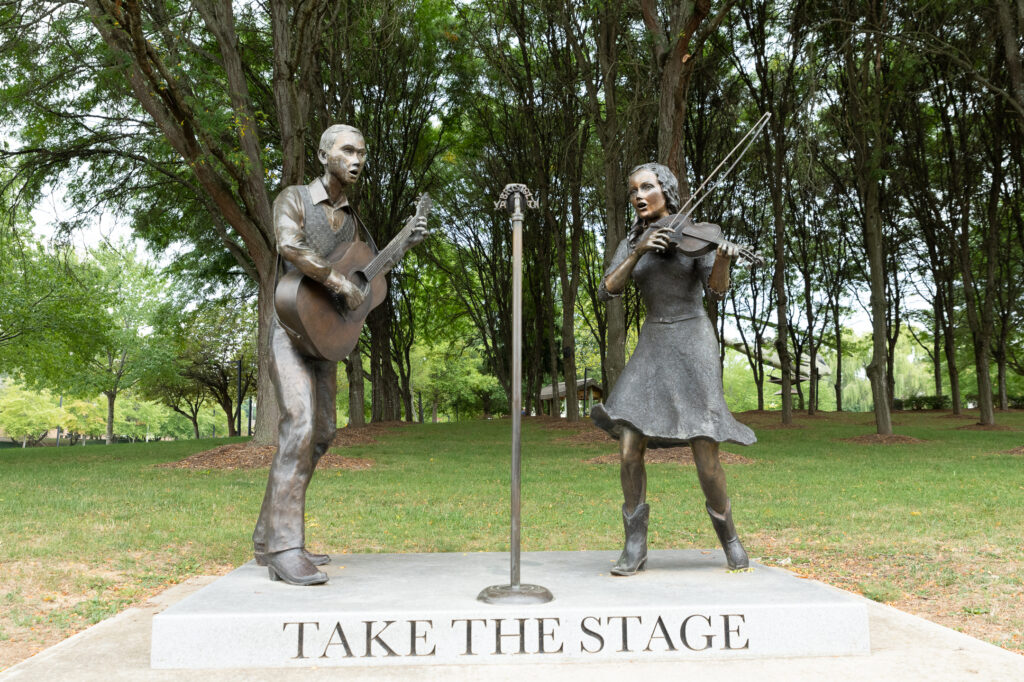 Take The Stage bronze statues of country singers.
