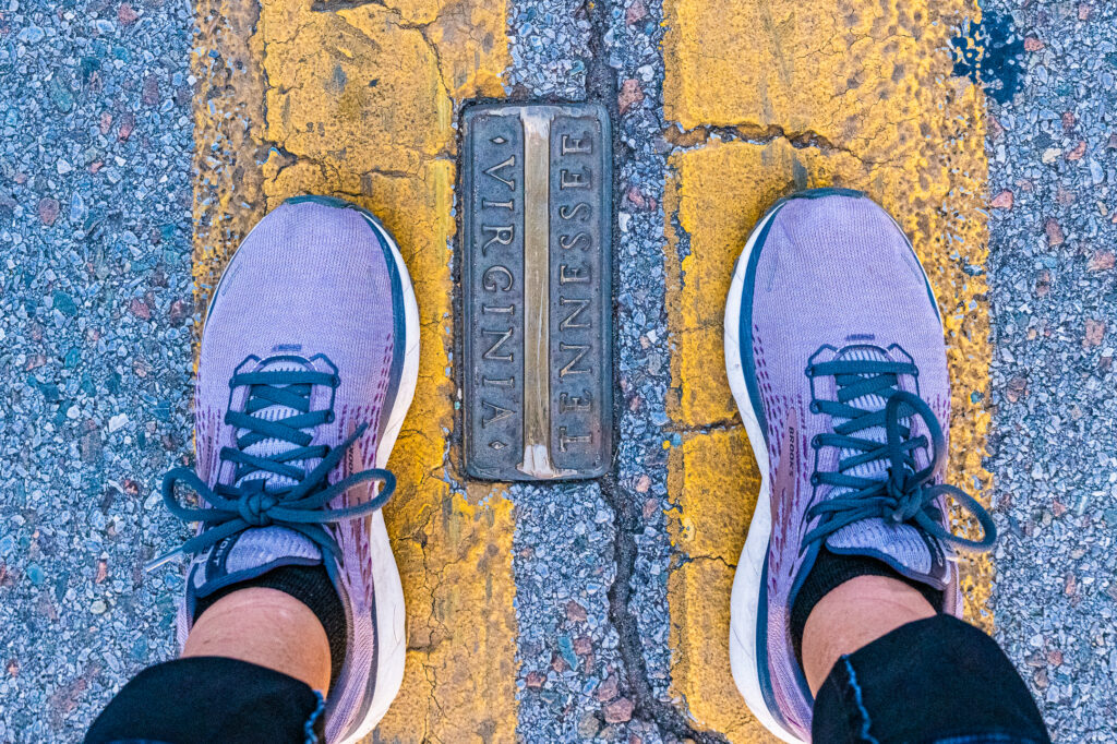 Two feet straddle state line on State Street in Bristol TN-VA.