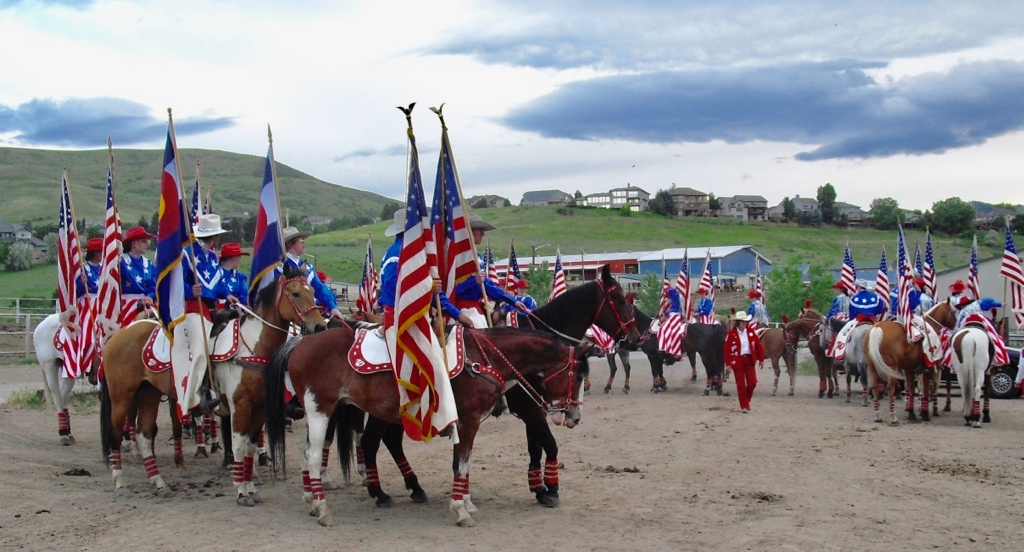 Westernaires practice in full costume at sunset in the Rocky Mountain town of Lakewood