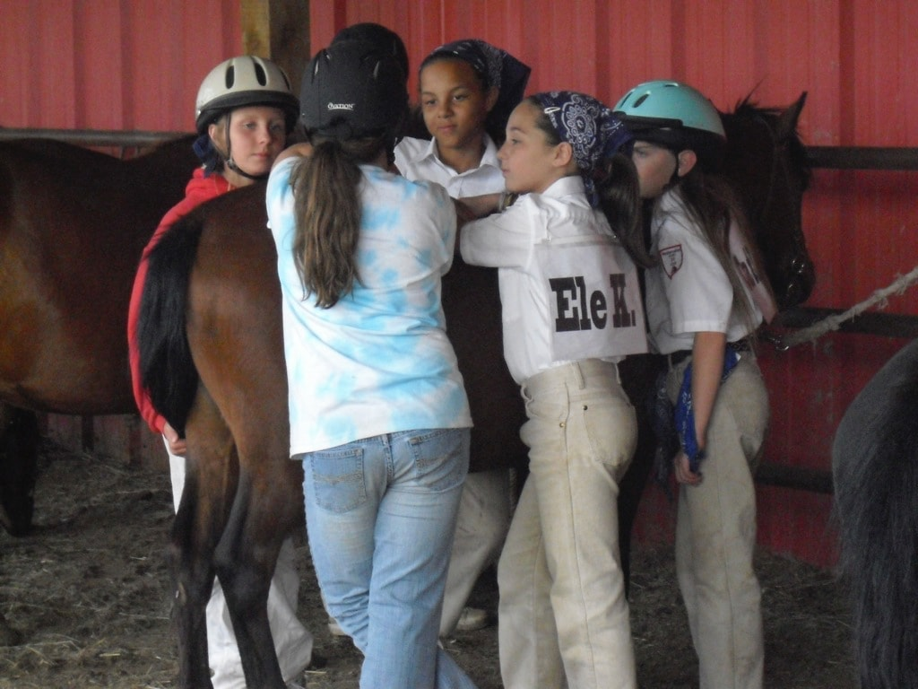 Young Westernaires converse over pony prior to practice