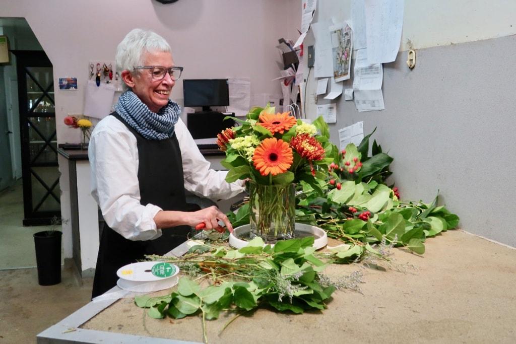 Charlotte Hennegan preparing a floral arrangement New London CT